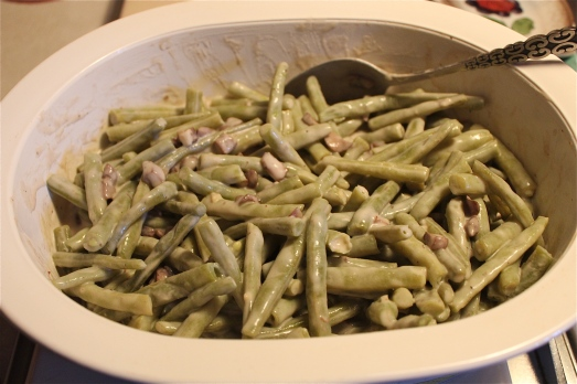 Green beans coated with sauce.