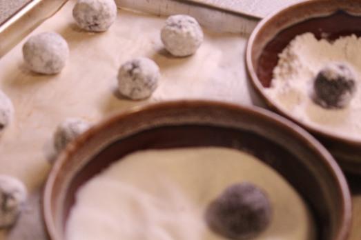 Roll first in regular sugar, then in powdered sugar.