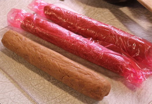 Roll the dough into 3 logs, wrap in plastic wrap and freeze.