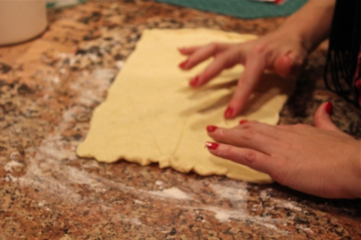 Pinch the seams together to make one square of dough.