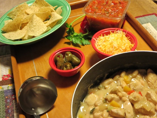 Serve with jalapeños, Jack cheese, white corn chips and salsa.
