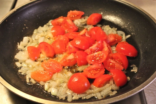 Saute onions and garlic, then add tomatoes.