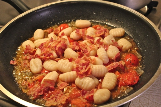 Once gnocchi are cooked, add to sauce with bacon.