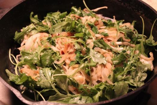 Next add the arugula and stir a bit till it wilts.