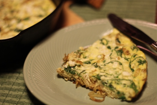 Onion and arugula frittata with goat cheese.