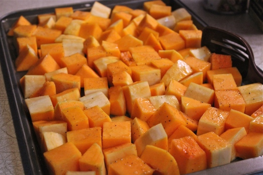 Dice squash, drizzle with olive oil, pepper and herbs, then bake.