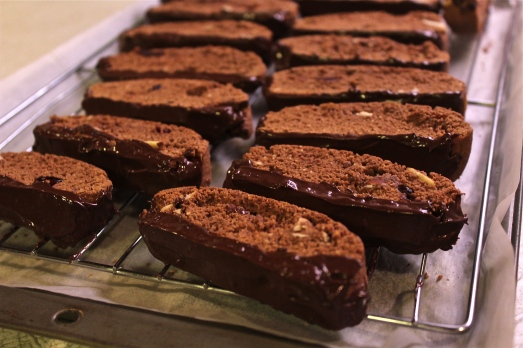 Dip bottoms of biscotti into melted chocolate.