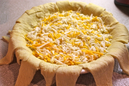 Put 1 cup cheese in bottom of pie dish.