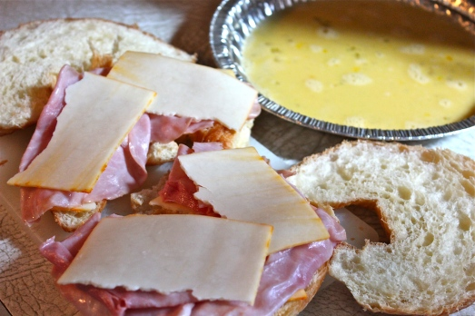 Layer up the ham and cheese, then dip the sandwich in egg.