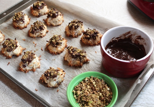 Dipping the tops into melted chocolate and sprinkling with pistachios.