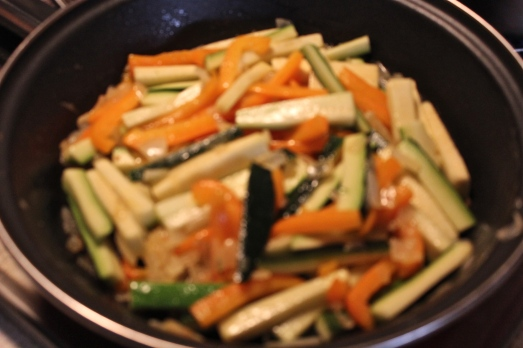 Sautéing the vegetables.