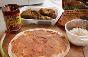 Spread refried beans over flour tortilla.