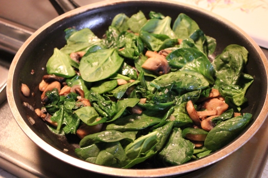 Mushrooms and spinach added to skillet.