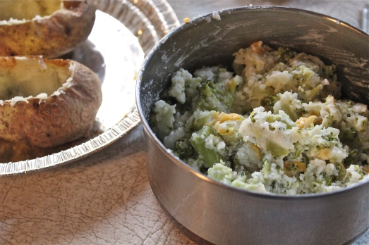 Mix potato with cooked broccoli, greek yogurt, milk and cheese.