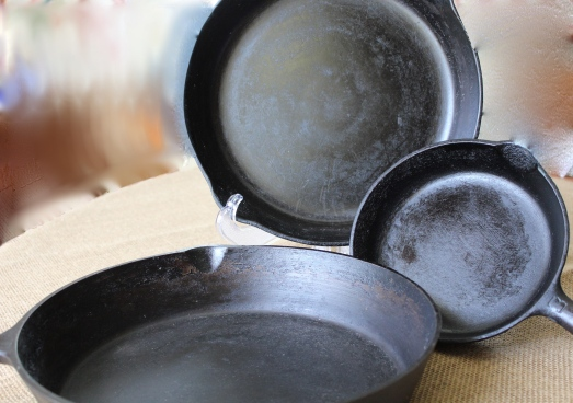 Cast iron skillets in several sizes.