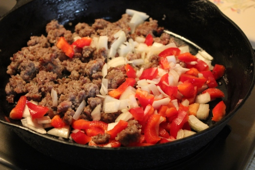 Cooking up the sausage, onion and pepper.