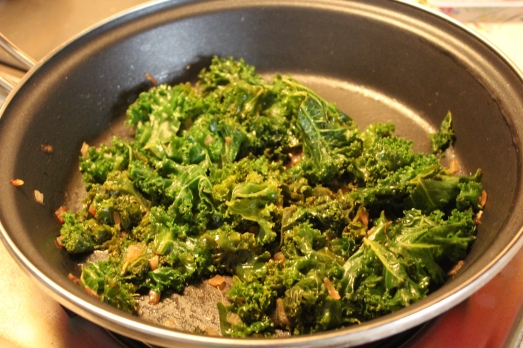 Add the kale and cook until it is wilted.