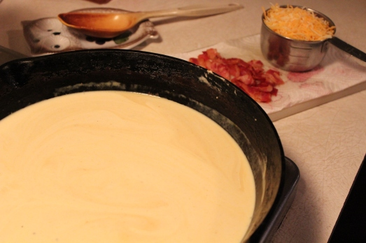 Making the cheese sauce with Alfredo sauce.