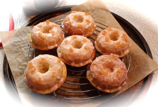Dip tops into glaze, sprinkle with zest.