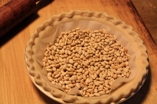 Fill with dried beans or pie weights prior to blind baking.