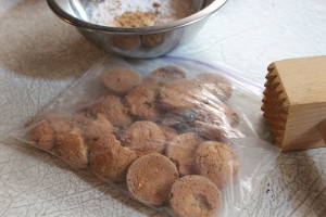Crush cookies by putting in zip-bag, and crushing with a meat tenderizer  or rolling pin
