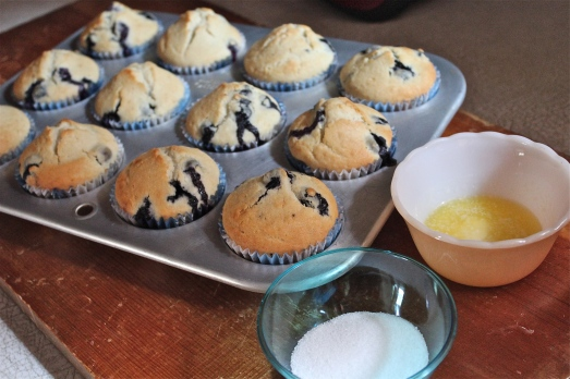 Brush tops with melted butter and sprinkle with sugar.
