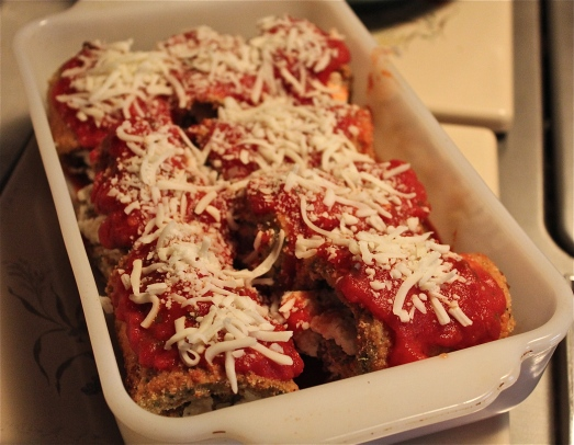Pour marinara sauce over the rolls and top with shredded mozzarella cheese.