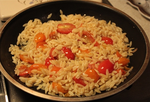 Add the cooked orzo and stir to combine.