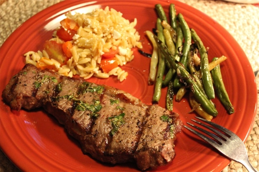 Grilled steak and green  beans with orzo mixture.