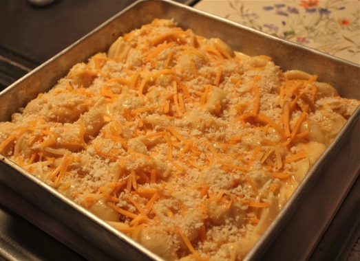 Top with remaining cheese and bake.