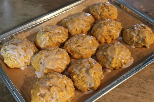 Drizzle scones with glaze.