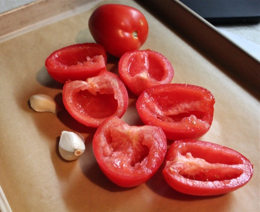 Cut in half and seed tomatoes.