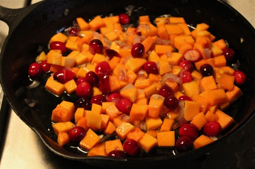 Add b-nut squash, cranberries, maple syrup and water.