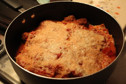 Lasagna cooked in a skillet.