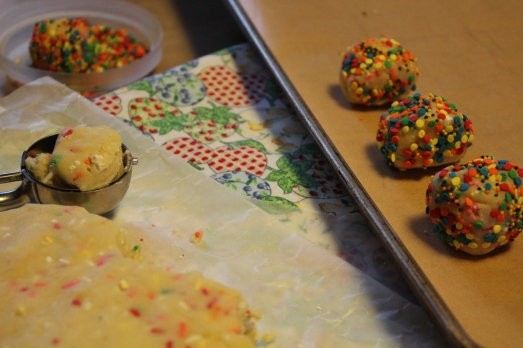 Form balls of dough, roll in more sprinkles, then chill.