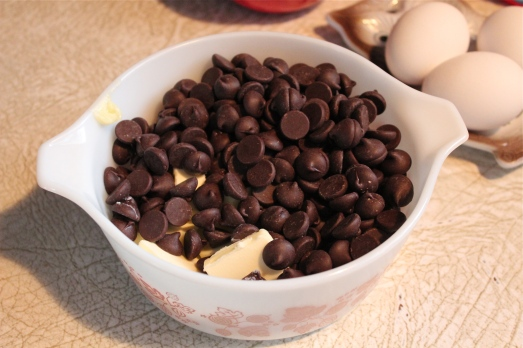 Choc. chips and butter in microwave safe bowl.