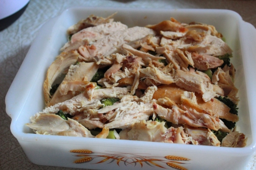 Cover broccoli with pieces of cooked chicken.