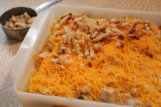 Add grated cheese over sauce.